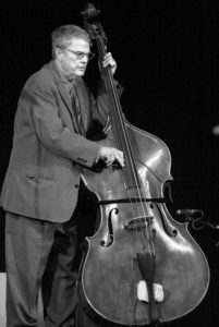 """Charlie Haden"" by Geert Vandepoele from Gent, Belgium - Charlie Haden. Licensed under Creative Commons Attribution-Share Alike 2.0 via Wikimedia Commons"